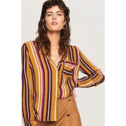 Koszula we wzory - Wielobarwn. Koszule damskie marki SOLOGNAC. W wyprzedaży za 49.99 zł.