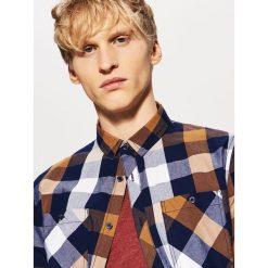 Koszula w kratę - Brązowy. Koszule damskie marki SOLOGNAC. W wyprzedaży za 49.99 zł.