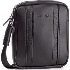 Saszetka CALVIN KLEIN - Essential 1 G Ipad Mini Reporter K50K504220 001. Czarne saszetki męskie Calvin Klein, ze skóry ekologicznej, młodzieżowe. Za 349.00 zł.