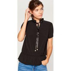 Koszula z wiązaniem przy dekolcie - Czarny. Koszule damskie marki SOLOGNAC. W wyprzedaży za 39.99 zł.