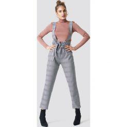 Trendyol Spodnie z szelkami - Grey. Szare spodnie materiałowe damskie Trendyol, w paski. Za 121.95 zł.