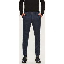 Spodnie na kant slim fit - Granatowy. Eleganckie spodnie męskie marki Giacomo Conti. W wyprzedaży za 119.99 zł.
