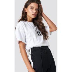Calvin Klein T-shirt Teco True Icon - White. Białe t-shirty damskie Calvin Klein, z nadrukiem, z bawełny. Za 202.95 zł.