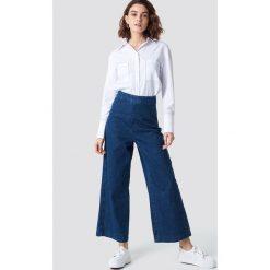 NA-KD Szerokie spodnie z denimu - Blue. Niebieskie spodnie materiałowe damskie NA-KD, z denimu. Za 161.95 zł.