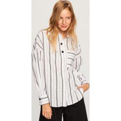 Koszula z ozdobnymi guzikami - Czarny. Koszule damskie marki SOLOGNAC. W wyprzedaży za 39.99 zł.