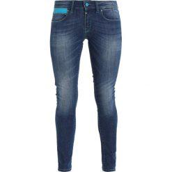 Dynafit Spodnie materiałowe jeans blue. Spodnie sportowe damskie Dynafit. Za 509.00 zł.