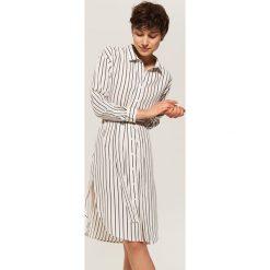 Koszulowa sukienka z wiązaniem - Kremowy. Białe sukienki damskie House, z koszulowym kołnierzykiem. Za 89.99 zł.