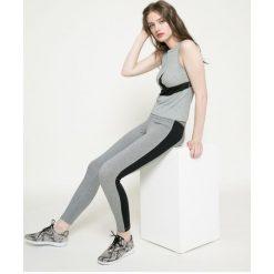 Nike - Legginsy. Legginsy sportowe damskie Nike, z bawełny. W wyprzedaży za 119.90 zł.