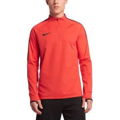 Nike Koszulka piłkarska Shield Strike Drill pomarańczowa r. L (807028 852). Koszulki sportowe męskie marki bonprix. Za 253.50 zł.