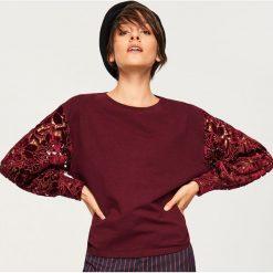 Bluza z ażurowymi rękawami - Bordowy. Bluzy damskie marki KALENJI. W wyprzedaży za 69.99 zł.