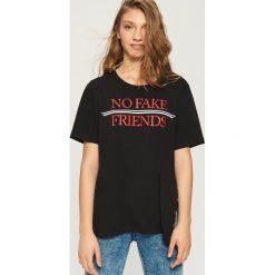 Bawełniany t-shirt oversize - Czarny. T-shirty damskie marki DOMYOS. W wyprzedaży za 14.99 zł.