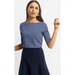 Koszulka z geometrycznym wzorem. Niebieskie bluzki damskie Orsay, w geometryczne wzory, z bawełny. Za 24.99 zł.
