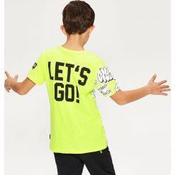 T-shirt z nadrukiem - Żółty. Żółte t-shirty dla chłopców Reserved, z nadrukiem. W wyprzedaży za 19.99 zł.