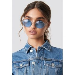 NA-KD Accessories Owalne kolorowe okulary przeciwsłoneczne - Blue. Okulary przeciwsłoneczne damskie marki QUECHUA. W wyprzedaży za 20.47 zł.
