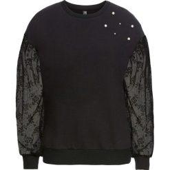 Bluza z koronkowymi rękawami bonprix czarny. Bluzy damskie marki KALENJI. Za 49.99 zł.