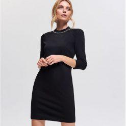 Sukienka z zabudowanym dekoltem - Czarny. Czarne sukienki damskie Reserved. Za 99.99 zł.