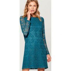 Sukienka mini z koronki - Turkusowy. Niebieskie sukienki damskie Mohito, w koronkowe wzory, z koronki. Za 99.99 zł.