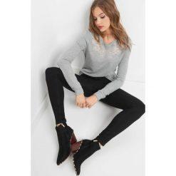 Jegginsy push-up. Czarne legginsy damskie Orsay, z bawełny. Za 79.99 zł.