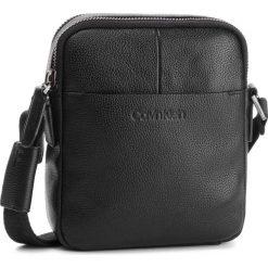 Saszetka CALVIN KLEIN - 2 Gusset Mini iPad R K50K503848 001. Czarne saszetki męskie Calvin Klein, ze skóry, młodzieżowe. Za 699.00 zł.