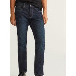 Jeansy slim fit z ociepleniem - Granatowy. Niebieskie jeansy męskie Reserved. Za 149.99 zł.
