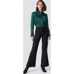 Emilie Briting x NA-KD Spodnie z szerokimi nogawkami - Black. Czarne spodnie materiałowe damskie Emilie Briting x NA-KD, z materiału. Za 161.95 zł.