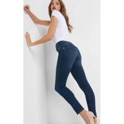 Jegginsy push-up. Niebieskie legginsy damskie Orsay, w paski, z bawełny. Za 79.99 zł.