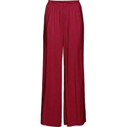 Szerokie spodnie bonprix czerwony. Spodnie materiałowe damskie marki DOMYOS. Za 79.99 zł.
