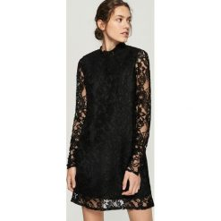 Koronkowa sukienka - Czarny. Czarne sukienki damskie Sinsay, z koronki. Za 79.99 zł.