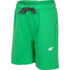 Spodenki dresowe dla małych chłopców JSKMD106 - zielony neon. Szorty dla chłopców marki 4F JUNIOR. W wyprzedaży za 29.99 zł.