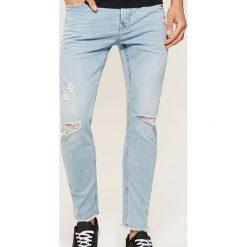 Jeansy slim z dziurami - Niebieski. Niebieskie jeansy męskie House. W wyprzedaży za 89.99 zł.