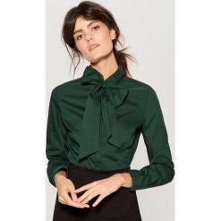 Koszula z wiązaniem na dekolcie - Khaki. Koszule damskie marki SOLOGNAC. W wyprzedaży za 49.99 zł.