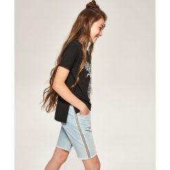 Jeansowe szorty z lampasami - Niebieski. Spodenki dla dziewczynek marki bonprix. W wyprzedaży za 29.99 zł.