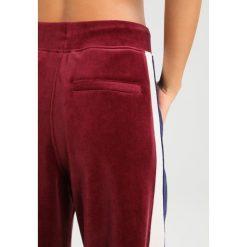 Fenty PUMA by Rihanna TRACK Spodnie treningowe tawny port/evening blue. Spodnie dresowe damskie Fenty PUMA by Rihanna, z bawełny. Za 759.00 zł.