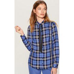 Koszula z kontrastowym wiązaniem - Niebieski. Koszule damskie marki SOLOGNAC. W wyprzedaży za 59.99 zł.
