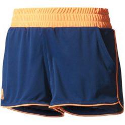 Adidas Spodenki Court Short Mystery Blue /Glow Orange M. Niebieskie szorty sportowe damskie Adidas, ze skóry, sportowe. W wyprzedaży za 109.00 zł.