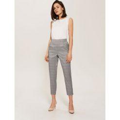 Spodnie tailoring - Granatowy. Spodnie materiałowe damskie marki DOMYOS. W wyprzedaży za 49.99 zł.