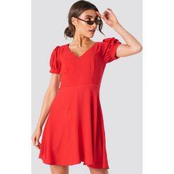 Trendyol Sukienka mini z dekoltem V - Red. Czerwone sukienki damskie Trendyol. Za 80.95 zł.