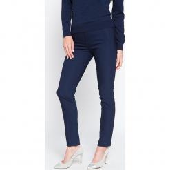 """Spodnie """"Sellier"""" w kolorze granatowym. Niebieskie spodnie materiałowe damskie Scottage, w paski. W wyprzedaży za 86.95 zł."""