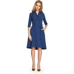Sukienka na zakładkę s099. Niebieskie sukienki damskie Style, biznesowe, z asymetrycznym kołnierzem. W wyprzedaży za 109.00 zł.