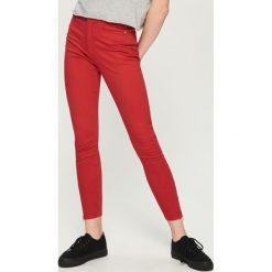 Spodnie skinny z zamkami - Pomarańczo. Spodnie materiałowe damskie marki DOMYOS. W wyprzedaży za 49.99 zł.