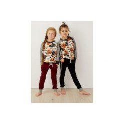 Spodnie joggery z lampasami. Czarne spodnie materiałowe dla dziewczynek Cudikids, z aplikacjami, z bawełny. Za 68.00 zł.