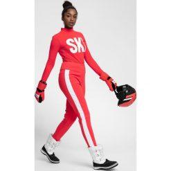 Spodnie narciarskie damskie SPDN101 - czerwony neon. Spodnie materiałowe damskie marki WED'ZE. W wyprzedaży za 329.99 zł.