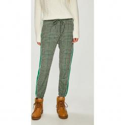 Trendyol - Spodnie. Szare spodnie materiałowe damskie Trendyol, z elastanu. Za 79.90 zł.