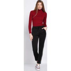 Czarne Spodnie Dresowe Patience. Czarne spodnie dresowe damskie Born2be, z dresówki. Za 39.99 zł.