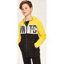 Rozpinana bluza z kapturem - Żółty. Bluzy dla chłopców Reserved. W wyprzedaży za 49.99 zł.
