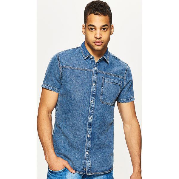 a3f15c63786613 Denimowa koszula z krótkim rękawem - Granatowy - Koszule męskie marki Cropp,  z krótkim rękawem. W wyprzedaży za 49.99 zł. - Koszule męskie - Odzież męska  ...