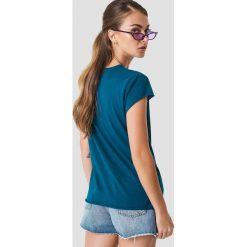 NA-KD T-shirt Offline - Blue. Niebieskie t-shirty damskie NA-KD, z nadrukiem, z okrągłym kołnierzem. Za 72.95 zł.