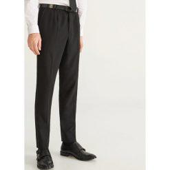 Spodnie garniturowe slim fit - Czarny. Eleganckie spodnie męskie marki Giacomo Conti. W wyprzedaży za 89.99 zł.