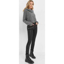 Spodnie z zamkami. Czarne spodnie materiałowe damskie Orsay, z bawełny. Za 129.99 zł.