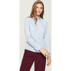Klasyczna koszula - Niebieski. Niebieskie koszule damskie Sinsay, klasyczne, z klasycznym kołnierzykiem. W wyprzedaży za 29.99 zł.